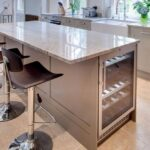 kitchen island with a wine fridge